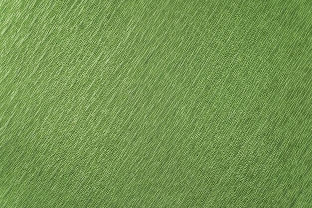 Gros plan de papier d'emballage vert. fond texturé vert.