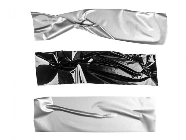 Gros plan d'un ruban adhésif sur blanc