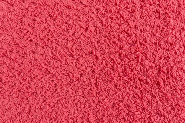 Gros plan d'une serviette rose. toile de fond de détails textiles.