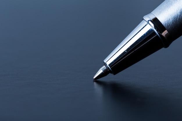 Gros plan, stylo, écriture, sombre, surface
