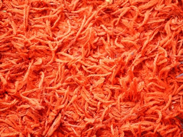 Gros plan de tapis orange. tapis laineux.