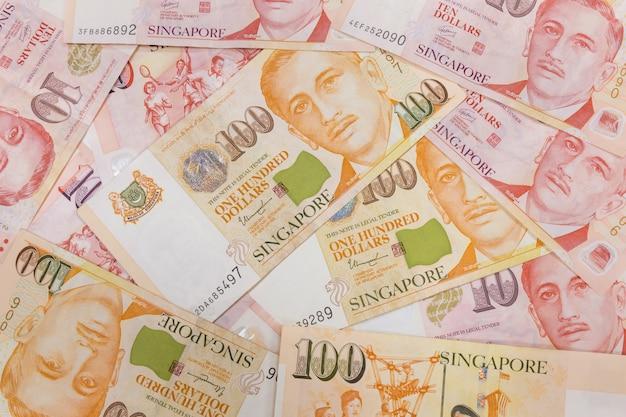 Gros plan d'un tas d'argent singapour et texture d'arrière-plan ou un motif