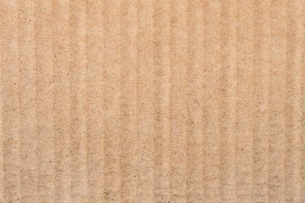 Gros plan sur la texture et l'arrière-plan de la boîte en papier brun