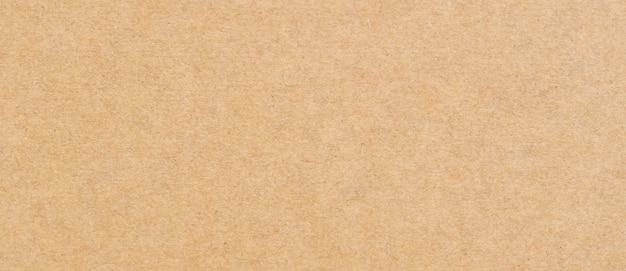 Gros plan sur la texture et l'arrière-plan du papier brun avec espace de copie