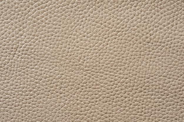 Gros plan de la texture de cuir beige transparente pour le fond