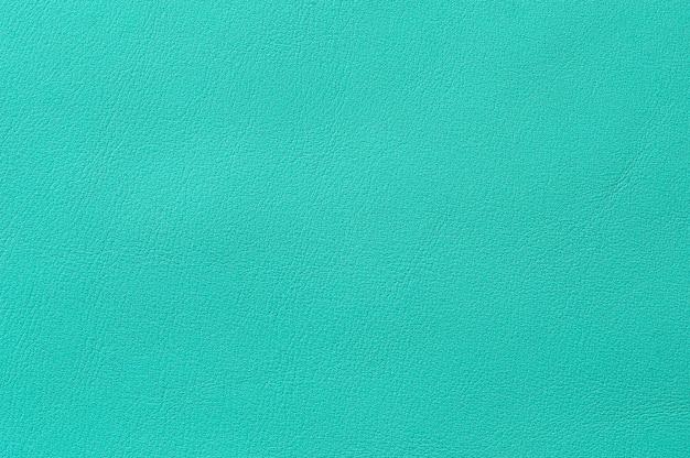 Gros plan de la texture en cuir bleu transparent pour le fond