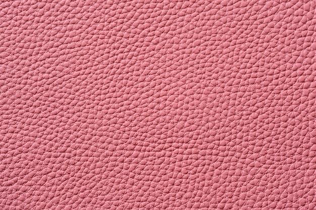 Gros plan de la texture en cuir rose transparente pour le fond