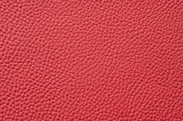 Gros plan de la texture en cuir rouge transparente pour le fond