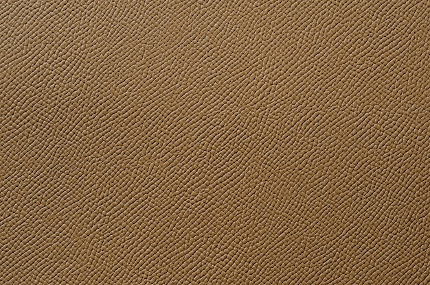 Gros plan de la texture du cuir marron sans couture pour le fond