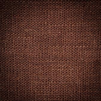 Gros plan sur la texture du lin marron. toile de fond pour la conception