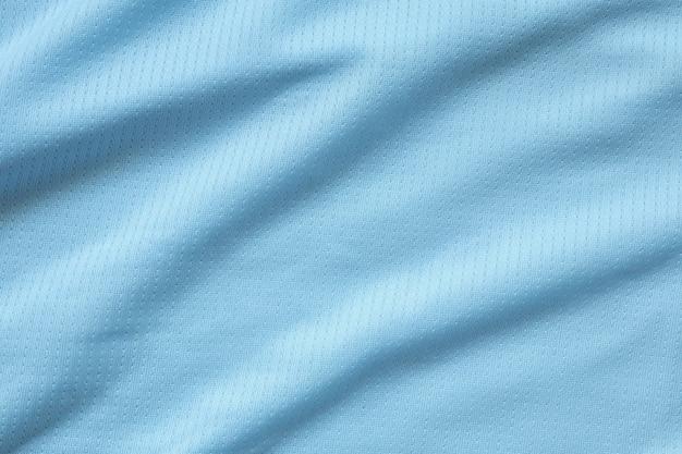 Gros plan sur la texture du maillot de football bleu