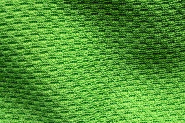 Gros plan sur la texture du maillot de football vert