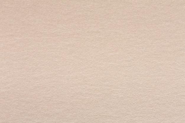 Gros plan sur la texture du papier beige clair. texture de haute qualité en très haute résolution