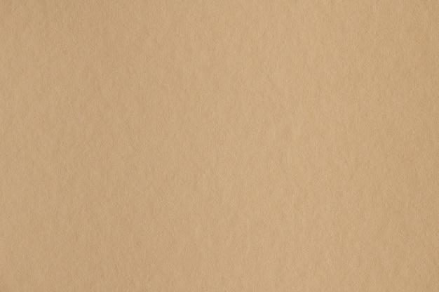 Gros plan de la texture du papier beige sans couture pour le fond ou les œuvres d'art