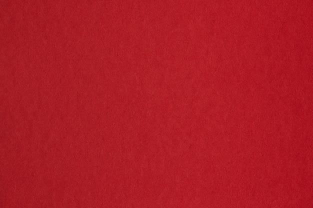 Gros plan de la texture du papier rouge sans couture pour le fond ou les œuvres d'art