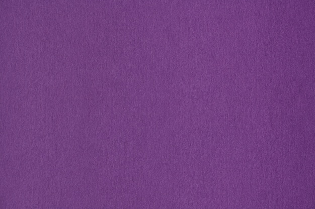 Gros plan de la texture du papier violet sans couture pour le fond ou les œuvres d'art