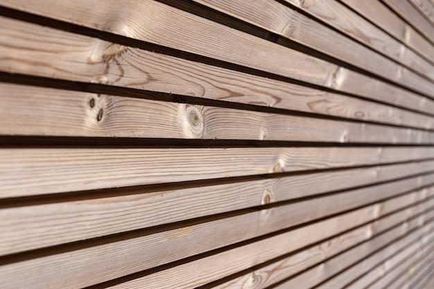 Gros plan de la texture de fond de boiseries. isolation thermique de façade en bois écologique moderne