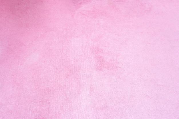 Gros plan de la texture de fond de tissu de velours rose, textile rose pastel doux