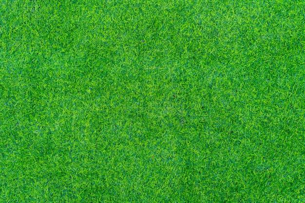 Gros plan de la texture de l'herbe artificielle