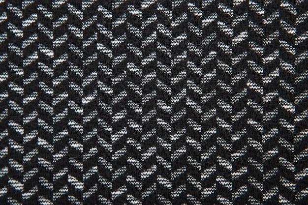 Gros plan de texture de modèle de tissu à chevrons noir et blanc