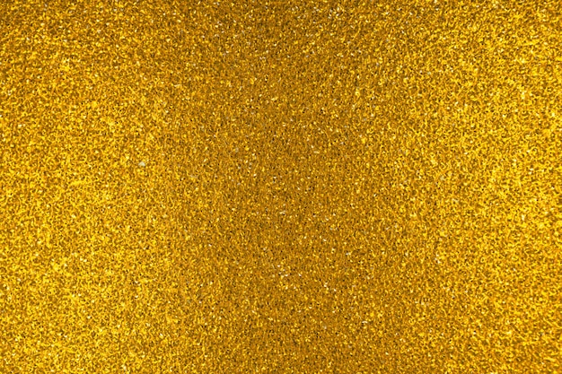 Gros plan sur la texture et le motif de paillettes d'or, surface brillante abstraite, luxe et photo d'arrière-plan rougeoyante