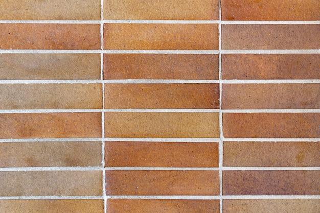 Gros plan d'une texture d'un mur fait de petites briques en pierre