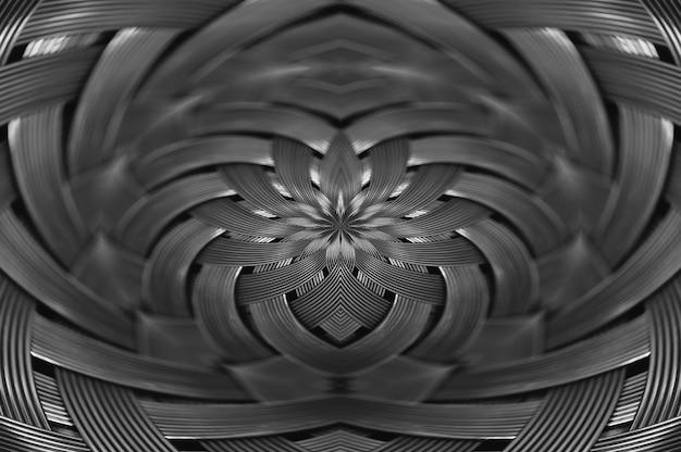 Gros plan de texture en osier métallique argent symétrique. fond de détail de la surface en acier de volume. résumé fil tressé gris en macro. forme surréaliste avec espace copie. espace noir et blanc inhabituel.