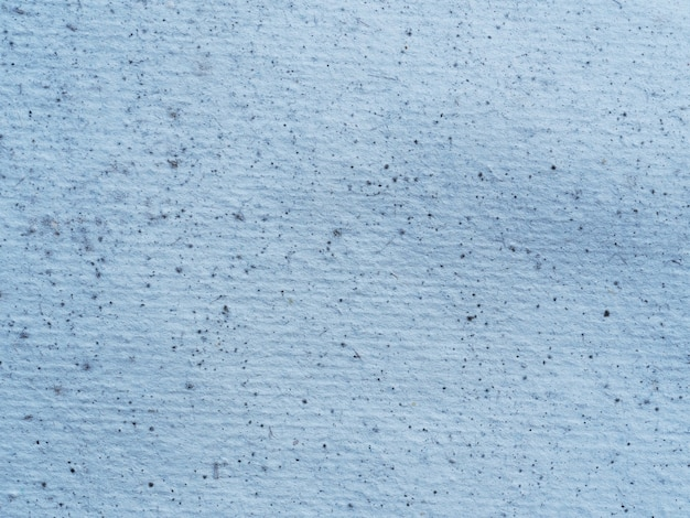 Gros plan d'une texture de papier recouverte de moisissure.