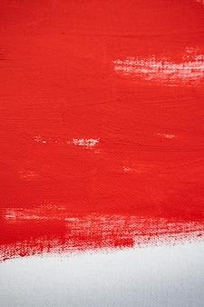 Gros plan texture peinture de couleur rouge sur toile de couleur blanche coup de pinceau pour la conception graphique de papier sur fond