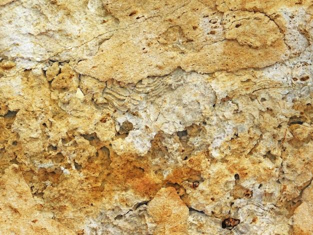 Gros plan de la texture de la pierre à l'extérieur