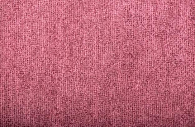 Gros plan de la texture de tissu tricoté rose transparente