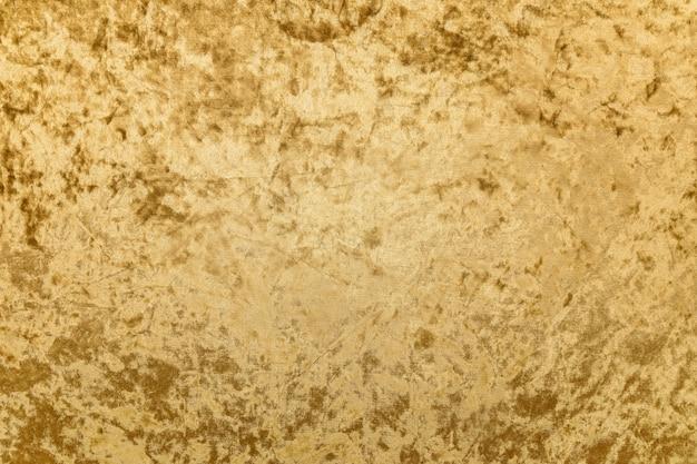 Gros plan texturé en tissu de velours doré