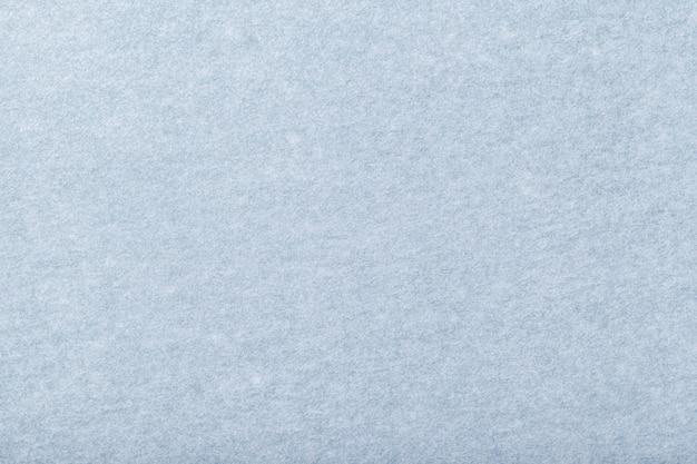 Gros plan de tissu en daim bleu clair mat. texture velours de fond de feutre