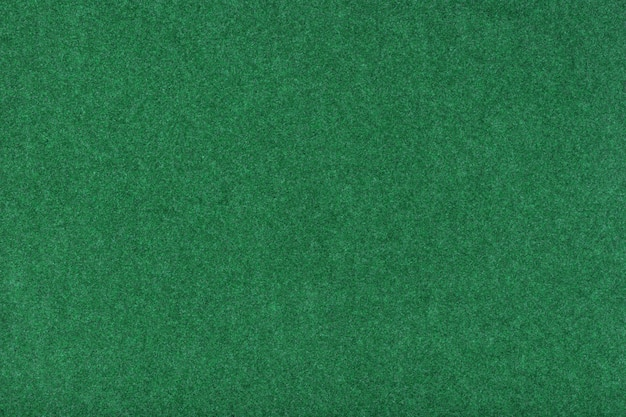 Gros plan de tissu en daim vert clair mat. texture velours de feutre.