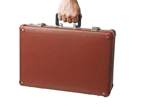 Gros plan sur la vieille vieille valise en main isolé