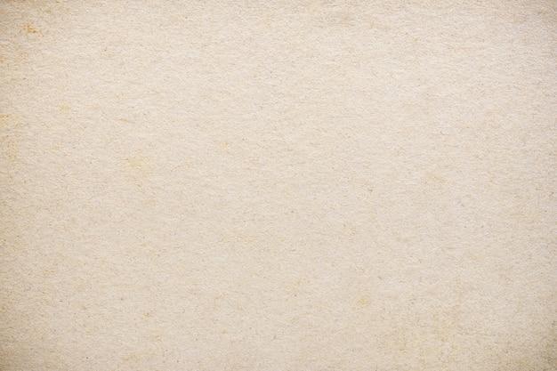 Gros plan sur le vieux papier peint de texture de papier brun