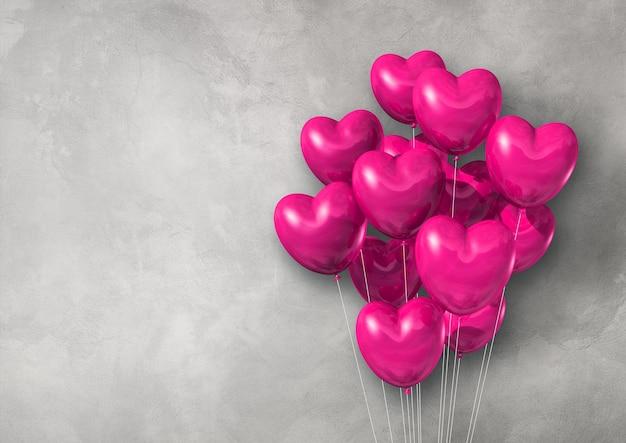 Groupe de ballons à air en forme de coeur rose sur un mur de béton. rendu d'illustration 3d
