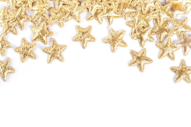 Groupe de décoration étoile d'or noël bonne année isolé sur fond blanc conception d'objet sur la vue de dessus