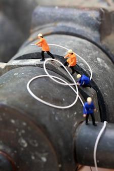 Groupe de pompier (miniature) travaillant.