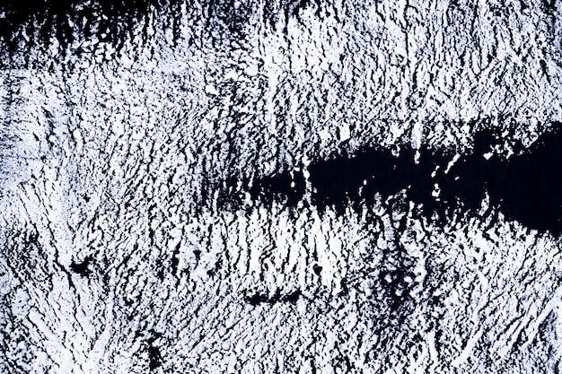 Grunge de tons noir et blanc. fond abstrait noir et blanc. la texture sombre comprend un effet fissures et éclats. texture grunge monochrome