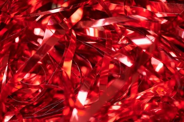 Guirlande rouge de fête, fond de vacances. remplissage décoratif de boîte-cadeau. conception de toile de fond colorée pour la publicité.