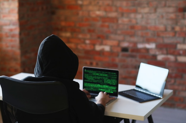 Hacker man on laptop