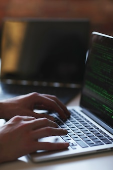 Hacker man on laptop