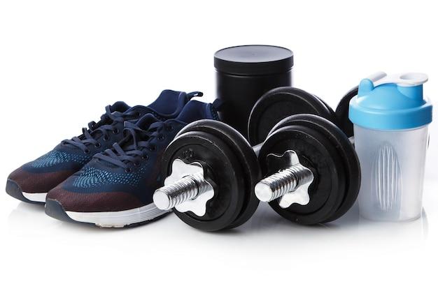 Haltères, baskets et shaker