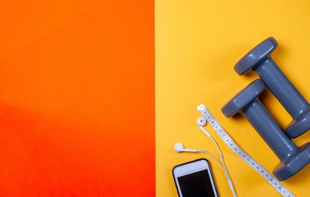 Haltères gris sur orange et jaune