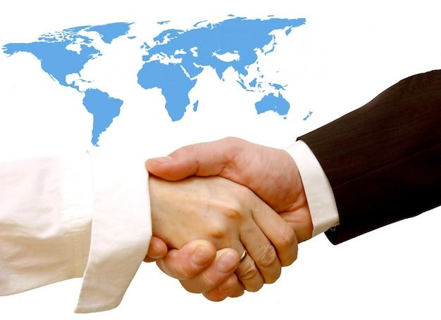 Handshake avec une carte du monde arrière-plan