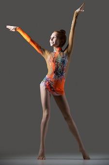 Happy gymnast girl dancing