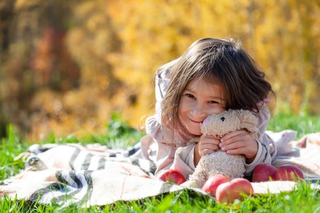 Happy kid baby woman in autumn park