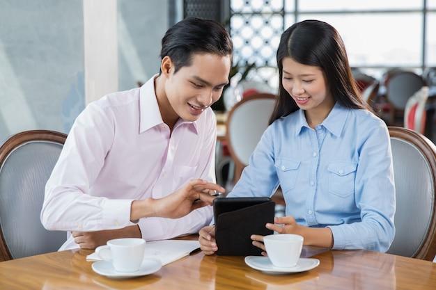 Happy people business utilisation tablet restaurant