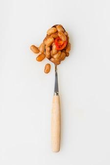 Haricots piments à plat dans une cuillère